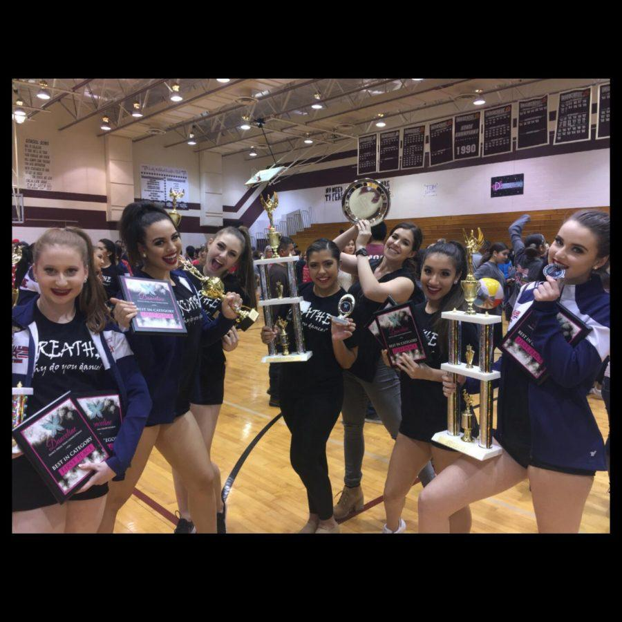 """The Starline officers pose with their many trophies after their competition in Calallen.""""I'm definitely proud of my girls,"""