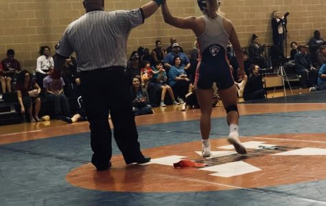 The Wrestling Team Defeats the Competition
